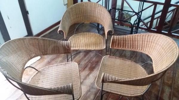 Four cane chairs and a stool