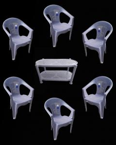 plastic table and six plastic chairs