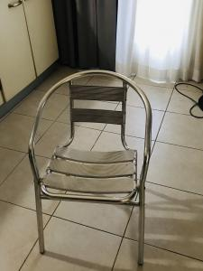 Stainless steel 6 chairs and 2 tables for sale